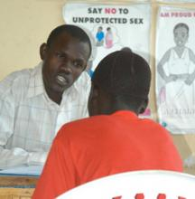 Source-© 2007 Gilbert Awekofua, Courtesy of Photoshare. Description-An adolescent (with back to camera) receives counseling prior to HIV testing at Gulu Youth Centre in northern Uganda.