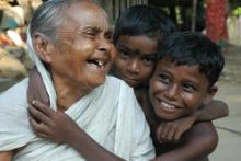 A grandmother laughs with her two grandsons in Howrah, India. © 2012 Susanta, Courtesy of Photoshare