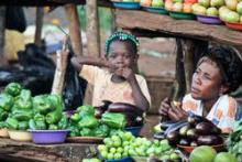 A mother and child sell vegetables at a roadside stand in Kampala, Uganda. © 2011 Rachel Steckelberg, Courtesy of Photoshare